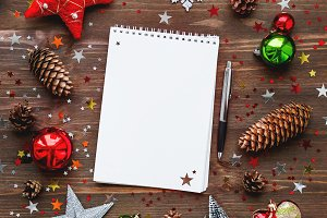 Christmas background with notepad.