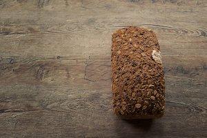 Bread on Wooden Board Background
