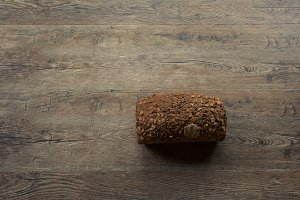 Bread on Wooden Board Background