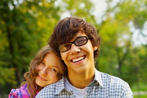 Happy teen couple in park