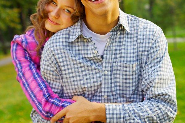 Happy teen couple in park