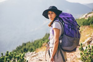 Young woman with a mountain backpack