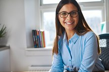 Cheerful woman working at desk