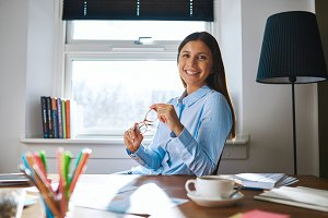 Smiling woman at desk in home office