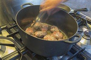 Frying meat in pan