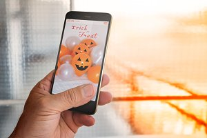 Smartphone with halloween background