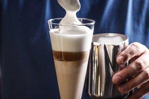 Barista making coffee latte