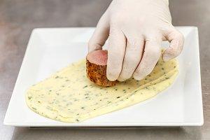 Chef garnishing a plate