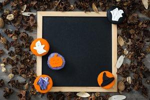 Halloween cupcakes and blackboard
