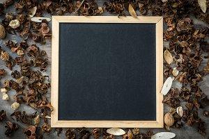 Blackboard and autumn leaves