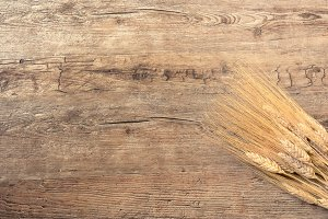 Wheat on wooden background
