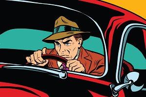 Serious retro man driving a car