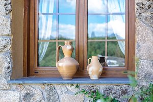 Rustic vases on window ledge