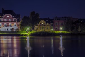 Houses by the lake by night