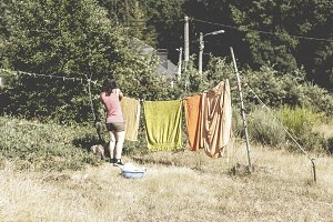 Woman hanging clothes on the line