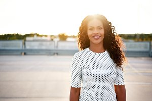 Smiling woman in polka dot blouse