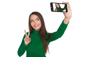 Beautiful girl photographs selfie