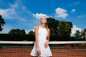 woman in a white tennis suit