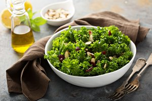 Fresh healthy salad with kale and cranberry