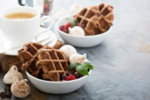 Chocolate waffles with meringues and coffee