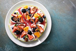 Watermelon pizza with fruits and yogurt