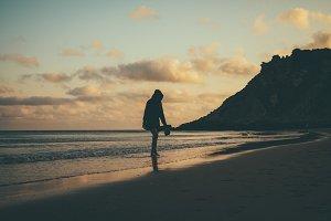 girl on beach at sunset