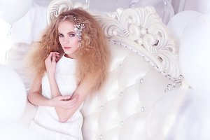 Young woman blond long curly hair