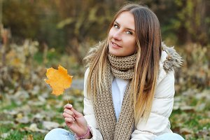 Portrait of cute girl in autumn park
