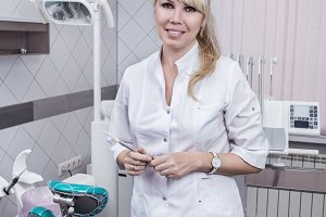 Portrait of blonde dentist.