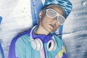 Hipster Girl DJ on the night Street.