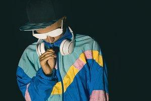 Hipster. Girl DJ at Night street