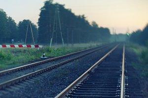 Railway in autumn mist. Blurry