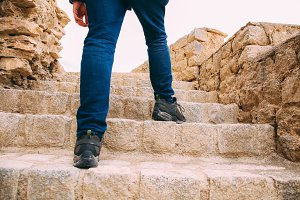 Hiker or Explorer going up on the stairs to archaeological site - Expedition and world explore