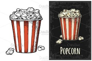 Carton bucket full popcorn.