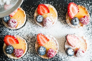 Berry tartlets with icing sugar