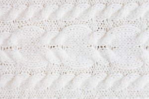 Abstract white knitted background.