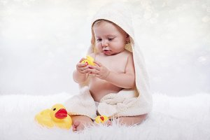 Happy baby in a towel
