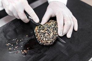 Chef cutting roasted tuna steaks