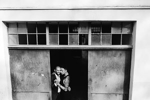 man and woman hugging in the doorway