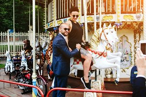 adult man and woman on a carousel