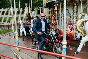 Man sitting at motorcycle on the carousel