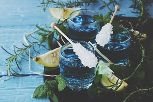 Blue curacao liqueur or sambuca with lemon