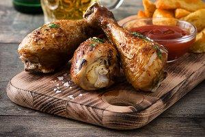 Roast chicken drumsticks and chips