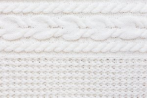 White abstract knitted background.