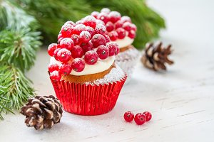 Christmas cupcakeon rustic background