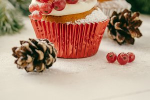 Christmas cupcakeon rustic background