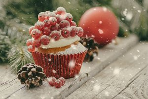 Christmas cupcake on rustic background