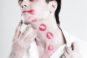 Red kisses on face