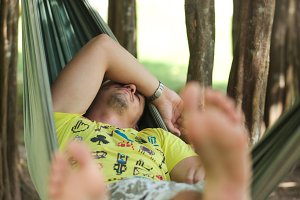 man in yellow t-shirt sleeping