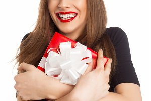 Happy model holding red present